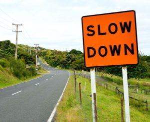 Road sign: slow down