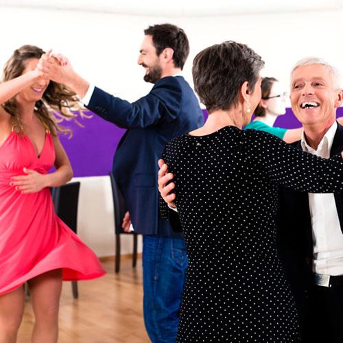 Happy couples dancing