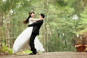 Groom lifting and spinning bride
