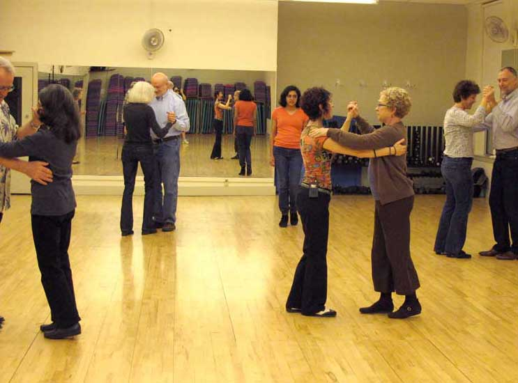 Branding leads class in practicing a new dance step