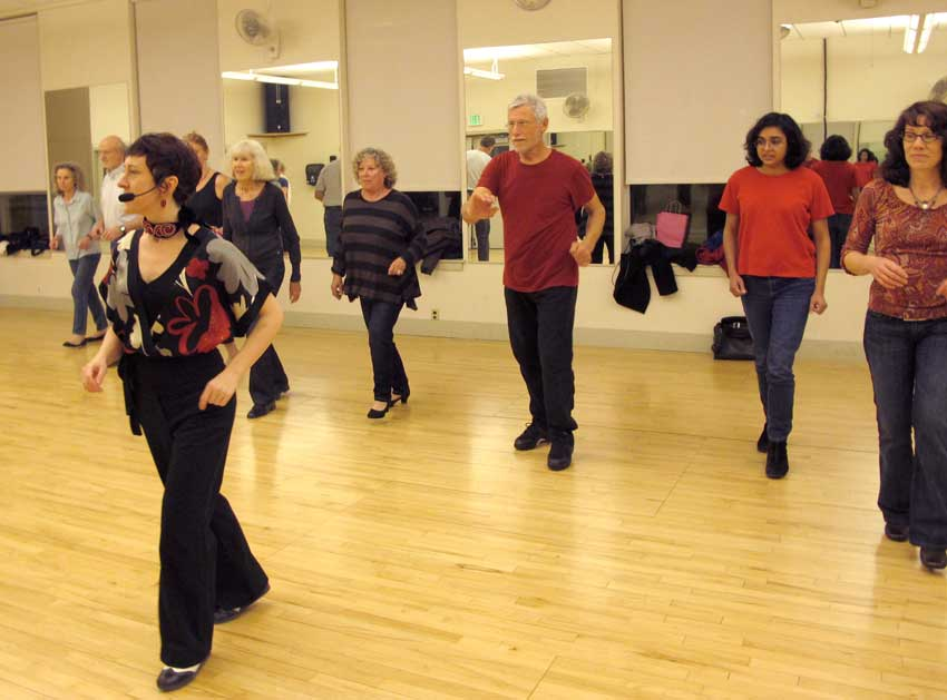 Brandee leads students in a Salsa class warmup