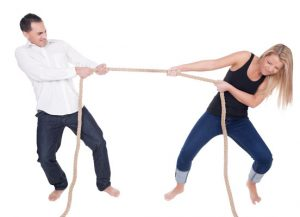 Man and woman in tug of war