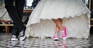 Bride wearing tennis shoes instead of heels