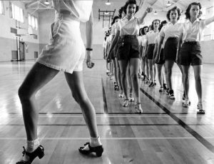 Women in a dance class memorize a routine